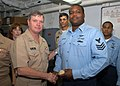 US Navy 060817-N-9805F-002 Commander, Naval Air Systems Command, Vice Adm. Wally Massenburg, presents one of his official flag coins to a member of USS Theodore Roosevelt (CVN 71), Aircraft Intermediate Maintenance Department (.jpg