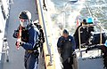 US Navy 070117-N-1134L-345 A Visit, Board, Search and Seizure (VBSS) Sailor assigned to coastal patrol ship USS Hurricane (PC 3) conducts an initial security sweep aboard Yard Patrol Craft 681 (YP 681) while his shipmates board.jpg