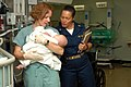 US Navy 070623-N-7088A-021 Lt. Kellie Kline holds young child as Capt. Wanda Richards looks on in a recovery room aboard the Military Sealift Command hospital ship USNS Comfort (T-AH 20).jpg