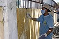 US Navy 070716-N-9195K-033 Aviation Boatswain's Mate (Fuel) 3rd Class Kendrick Manor scrapes old paint from a wall during an engineering civil action program at the Transitional Center for Da Nang Children in support of P.jpg