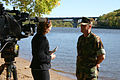 US Navy 071003-N-7163S-001 Cmdr. Dan Shultz, commanding officer of Mobile Diving and Salvage Unit (MDSU) 2, interviews with KSTP-TV reporter Colleen Mahoney along the banks of the Mississippi River near downtown Minneapolis.jpg