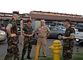 US Navy 071023-N-4973M-015 Capt. Jim Wink, commanding officer of Amphibious Construction Battalion (ACB) 1, Command Master Chief Damon L. Anthony and Lt. Joseph Roach, a Navy chaplain, discuss disaster relief efforts.jpg