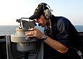 US Navy 080822-N-4044H-002 Quartermaster Seaman Apprentice Derek Evoy looks through a telescopic alidade.jpg