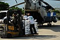 US Navy 080909-N-4515N-047 Port-au-Prince citizens help Sailors embarked aboard the amphibious assault ship USS Kearsarge (LHD 3) with hurricane relief efforts.jpg