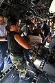 US Navy 080913-N-7955L-037 Service members embarked aboard the amphibious assault ship USS Kearsarge (LHD 3) load supplies onto helicopters for delivery to areas affected by recent hurricanes in Haiti.jpg