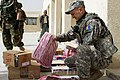US Navy 090317-N-9286M-030 Navy Capt. Robert Lansden, Ponchatoola, La. assigned to the 304th Civil Affairs Brigade, inspects school supplies before delivering them to children at the Khawr Az Azubayr Primary School in Basrah, I.jpg