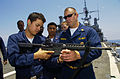 US Navy 090723-N-3925A-002 Chief Master-At-Arms James Bolibrzuch instructs Operations Specialist Seaman Recruit Michael Perez on weapons handling techniques before a live-fire exercise aboard the amphibious transport dock ship.jpg