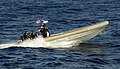 US Navy 100217-N-7058E-175 A rigid-hull inflatable boat carries Sailors and Coast Guardsmen from the littoral combat ship USS Freedom (LCS 1).jpg