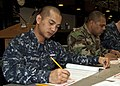 US Navy 100304-N-5019M-003 Hospital Corpsman 2nd Class Arturo Bantugan takes the Navy-wide petty officer 1st class advancement exam at Club Alliance at.jpg