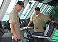 US Navy 100319-N-7058E-373 Cmdr. Randy Garner explains the officer of the deck control station on the bridge to Colombian navy Chief of Naval Operations Vice Adm. Alvaro Echandia.jpg