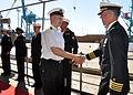 US Navy 100628-N-5483N-004 Capt. Karl Thomas, commanding officer of the amphibious command ship USS Mount Whitney (LCC-JCC 20), greets Capt. Rimants Strimaitis, commander of the Latvian navy, aboard Mount Whitney.jpg