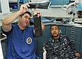 US Navy 100824-N-1004S-149 t. Frederick Rumford explains x-ray results to Machinist Mate 1st Class Tyrone Perriott during a dental examination.jpg