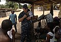 US Navy 110407-N-HI707-825 Capt. Lawrence Rollo cradles a Nigerian baby while visiting with locals during a community relations project at the Ligh.jpg