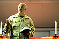 US Navy 110416-N-6505H-027 hief of Chaplains Rear Adm. Mark L. Tidd addresses a Roman Catholic congregation during mass in the chapel aboard USS Ca.jpg