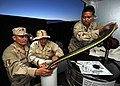 US Navy 110604-N-PM781-069 Sailors assigned to Maritime Expeditionary Security Squadron (MSRON) 1, pump lube oil for their camp generator.jpg