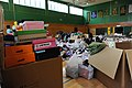 US Navy 110624-N-ZZ999-070 Stacks of shoeboxes await sorting as Misawa Air Base personnel organize materials donated to Japan by listeners of the S.jpg