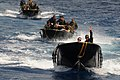 US Navy 110628-N-YO394-195 A Royal Netherlands Marine, front, directs Sailors assigned to Riverine Squadron (RIVRON) 3 during maneuvers near the Ro.jpg