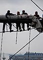 US Navy 110629-N-SH953-348 Sailors place the sail on the yard of the main mast aboard USS Constitution for the first time since the ship began a re.jpg