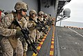 US Navy 110910-N-KS651-945 Marines assigned to the 11th Marine Expeditionary Unit (11th MEU) participate in a live-fire exercise aboard the amphibi.jpg