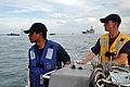 US Navy 111012-N-YX169-383 Engineman Fireman Ian Castil and Boatswain's Mate 3rd Class Christopher Widmar man a 7-meter rigid-hull, inflatable boat.jpg