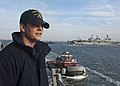 US Navy 111215-N-FI736-116 Information Systems Technician 3rd Class Erick Tiernan watches as Arleigh Burke-class guided-missile destroyer USS James.jpg