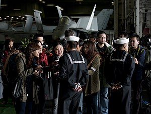 US Navy 111227-N-DR144-474 Sailors speak to the Hong Kong press.jpg