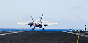 US Navy 120206-N-OY799-386 A jet launches off the flight deck.jpg
