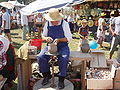 Ukrainian Potter with potter's kick wheel.JPG