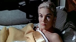 "Vertigo (film) - Kim Novak as ""Madeleine"", who has woken up naked in Scottie's bed after an apparent suicide attempt by drowning."