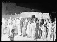 Villagers of el Khadder, listening in to radio of a passing car at night, Oct. 1937 LOC matpc.22265.jpg