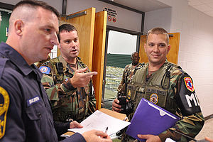Virginia Defense Force - Members of the Virginia Defense Force, Shelter Augmentation Liaison Team provide assistance to the Virginia State Police during the 2011 State Managed Shelter Exercise.