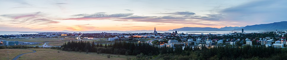 Panorama of Reykjavík seen from Perlan at sunset in summer. As seen in the picture, Reykjavík is mild enough for trees to grow.