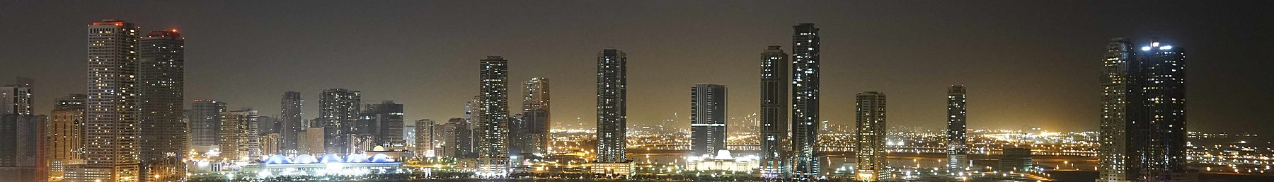 WV banner Sharjah emirate Al Khan lagoon by night.jpg