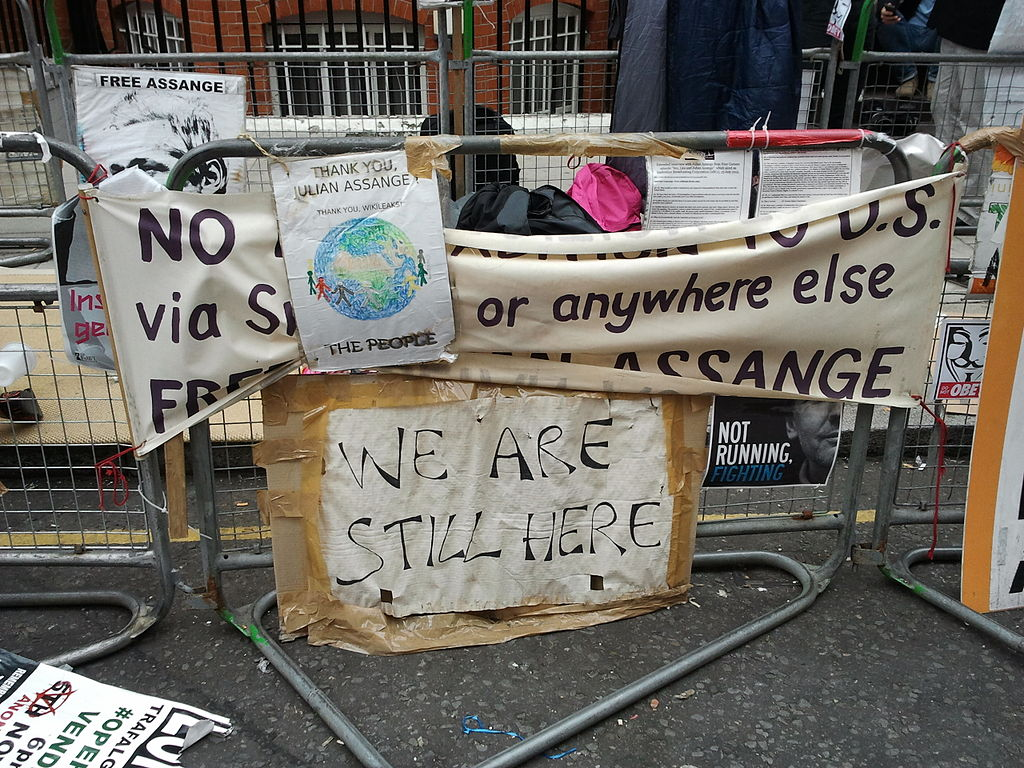 We are still here, placards in front of Ecuador embassy.jpg