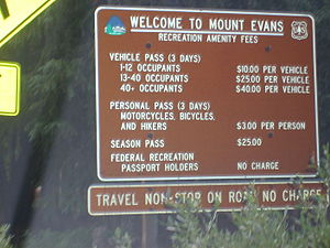 Mount Evans Scenic Byway - Entrance sign explaining fee structure.