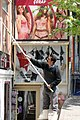 Window Washer with Lingerie Backdrop - Beyoglu District - Istanbul - Turkey (5719708192).jpg