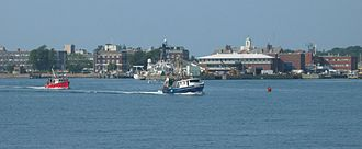 Woods Hole, Massachusetts - A view of downtown Woods Hole from the water, including MBL and WHOI buildings
