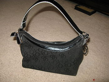 English: An XOXO brand purse.