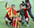 Xavi and Sergio Busquets Euro 2012 trophy.jpg