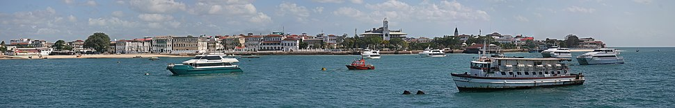 A panorama of Stone Town taken from the Indian Ocean. Seen in the picture are the Sultan's palace, House of Wonders, Forodhani Gardens, and St. Joseph's Cathedral