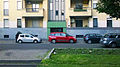 """14 - ITALY - Automobiles parking in Milan - Fiat 500 L living - four automobiles - facing right.jpg"