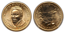 A gold medallion depicting a man and a mobile