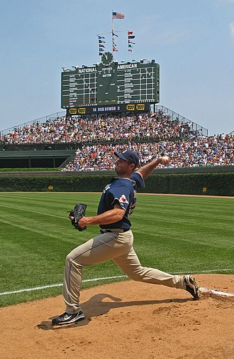 Starting pitcher - Chris Young warms up in the bullpen before a game at Wrigley Field minutes before the 12:05 start (see scoreboard clock).