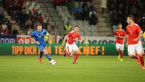 Aron Gunnarsson - Aron (left) playing for Iceland in 2014
