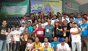 Gamma Kappa Phi - Gamma Kappa Phi members with founders Landy Maslog and Prisco Viñalon in front of the organization's founding school of Holy Name University, during the 50th Anniversary and 3rd Annual International Convention held in Tagbilaran City on October 7–10, 2012.