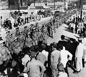 Occupation of Japan - May 1946. The 2nd Battalion 5th Royal Gurkha Rifles march through Kure, Hiroshima soon after their arrival in Japan.