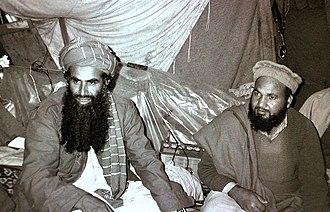 Abdul Rasul Sayyaf - Sayyaf (left) as Afghan mujahideen commander in 1984.