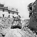A British Sherman tank advancing through Imprunetta, Italy, 3 August 1944. NA17565.jpg