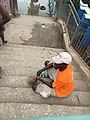 A Man without hands sweeping the Anthony bridge in Lagos.jpg