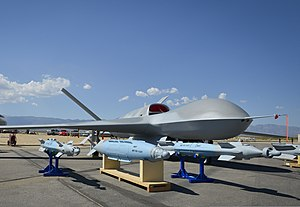 A Predator C Avenger unmanned aircraft system and inert ordnance sit on display on a tarmac at Palmdale, Calif., Aug. 8, 2012 120808-N-WL435-054.jpg